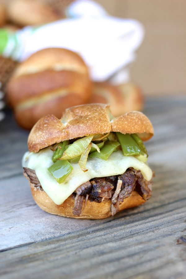 Crockpot Shredded Beef Sandwiches - juicy, tender shredded beef sandwiches with baby swiss cheese, sautéed peppers and onions on a buttery, toasted roll