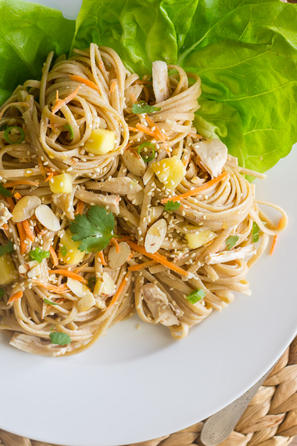 Chicken, sweet mangos, crunchy almonds, and fresh veggies piled high on a bed of sesame noodles.