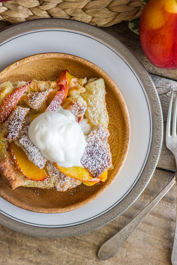 Peaches and Cream French Toast Bake - topped with juicy, ripe, peaches & homemade whipped cream