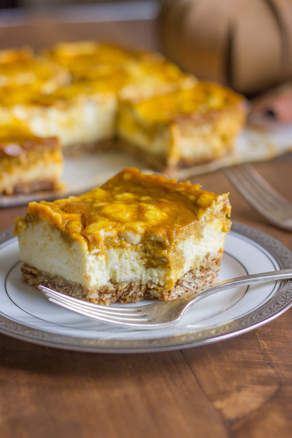Pumpkin Pie Cheesecake Bars - pumpkin pie and creamy cheesecake swirled together on a thick, buttery oatmeal cookie crust!