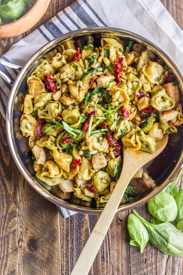 One Skillet Chicken Tortellini - pesto, sun-dried tomatoes, toasted pine nuts, and spinach. It's VERY easy to put together, and has SO much flavor!