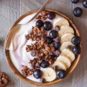 Chocolate Hazelnut Granola Yogurt Bowl - Creamy yogurt topped with blueberries, bananas and homemade Chocolate Hazelnut Granola.