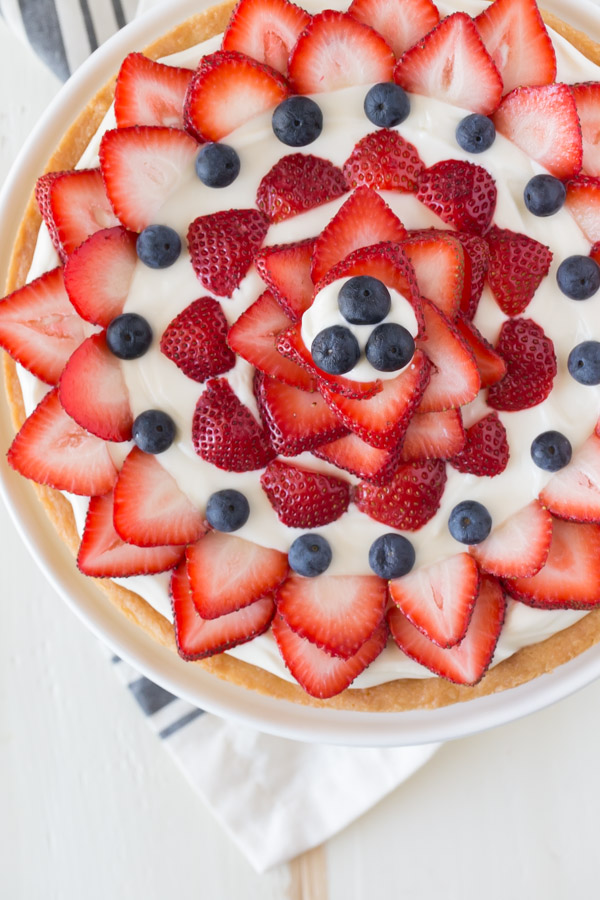 Strawberry Cream Cheese Tart - A buttery shortbread crust topped with a sweetened cream cheese filling and fresh berries. Easy, delicious, and patriotic!