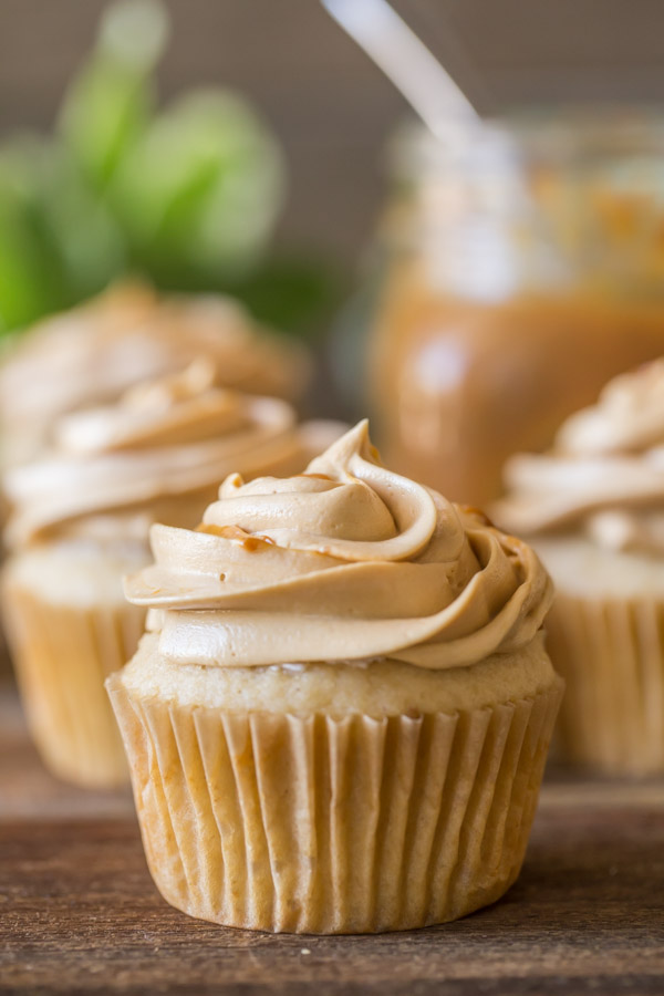 Apple Cupcakes With Dulce De Leche Buttercream - Sweet and tart apple cupcakes are topped with a buttercream and dulce de leche swirl! Match made in heaven!