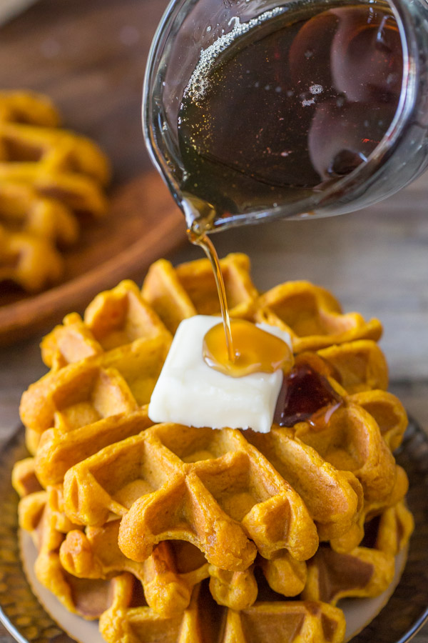 Pumpkin Spice Waffles - Made with pure pumpkin puree and coconut oil, these waffles are moist, fluffy and ready for maple syrup!