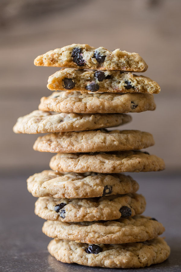 Blueberry White Chocolate Chip Cookies - A delightfully chewy cookie with dried blueberries, white chocolate chips, toasted coconut, and hearty oats!
