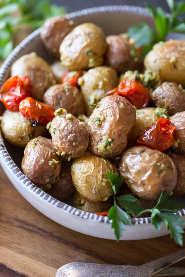 A quick and easy alternative to your typical potato salad, these Roasted Baby Potatoes With Pesto are absolutely delicious!